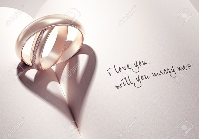 10785054-heartshadow-with-rings-on-a-book-middle-i-love-you-will-you-marry-me-card-Stock-Photo